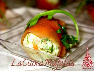 involtini di salmone con formaggio, rucola e noci