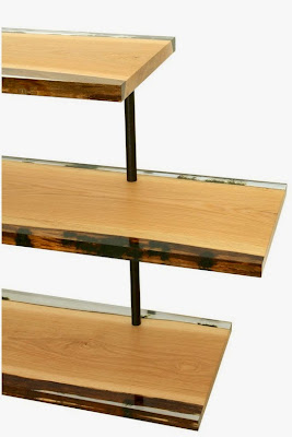 three shelves with the edges encapsulated with resin and moss