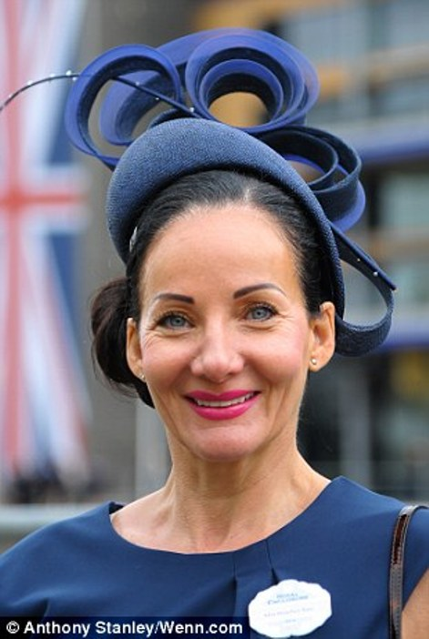 elegant lady in a navy outfit with beautiful hat on day 2 at Royal Ascot 2014