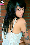 Its just sort of there looking good with cool tattoos. (hot girls with tattoos )