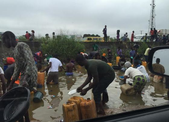 Wow! Ibafo residents scoop fuel from fallen tanker...(photos)