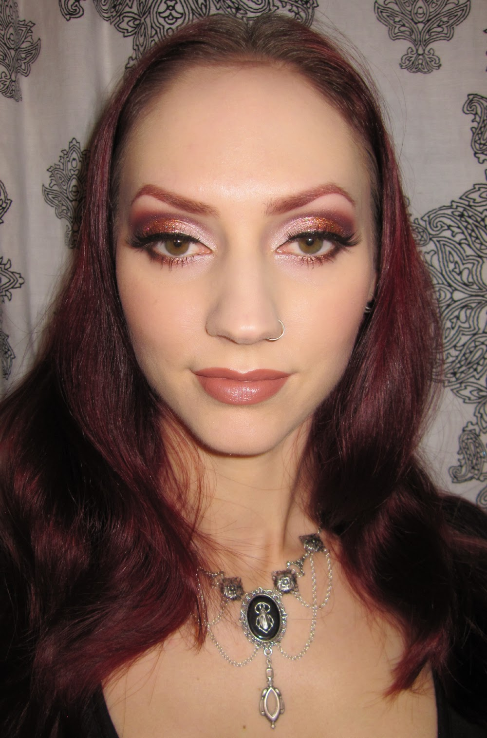 http://themoonmaiden-blix.blogspot.com/2014/11/peach-and-plum-wine-glitter-eye-makeup.html