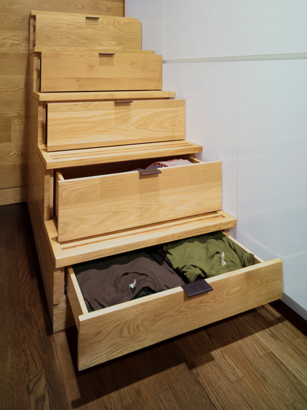 Photo of storage space built into the wooden stairs leading to the elevated bed