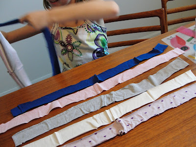 child sorting t-shirt strips for dog toy