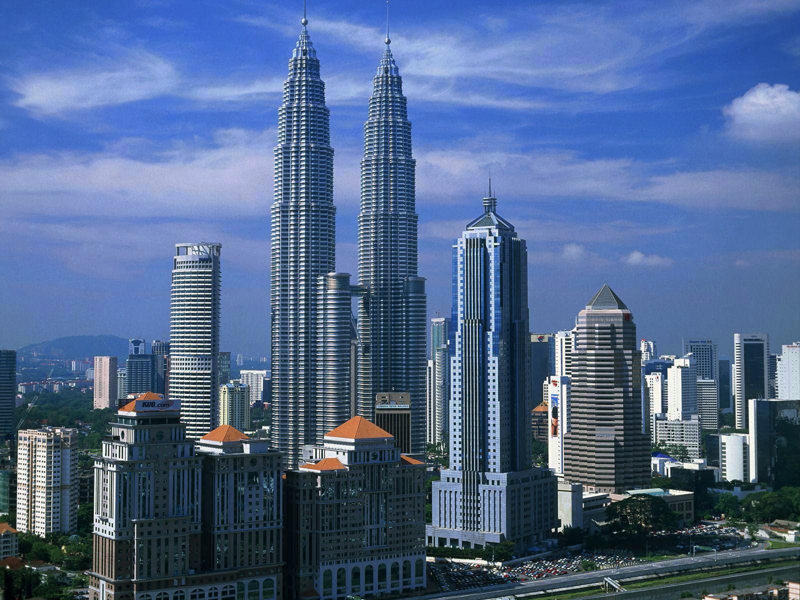 Petronas Twin Towers In Kuala Lumpur Malaysia Beautiful Traveling Places