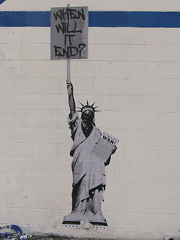street art in Pasadena California by common cents - Statue of Liberty wearing a mask holding a sign When Will It End?