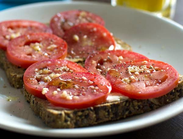 Sliced Tomatoes on Toasted Bread for Breakfast. Recipes Don't Get Any Easier Than This Healthy Idea.