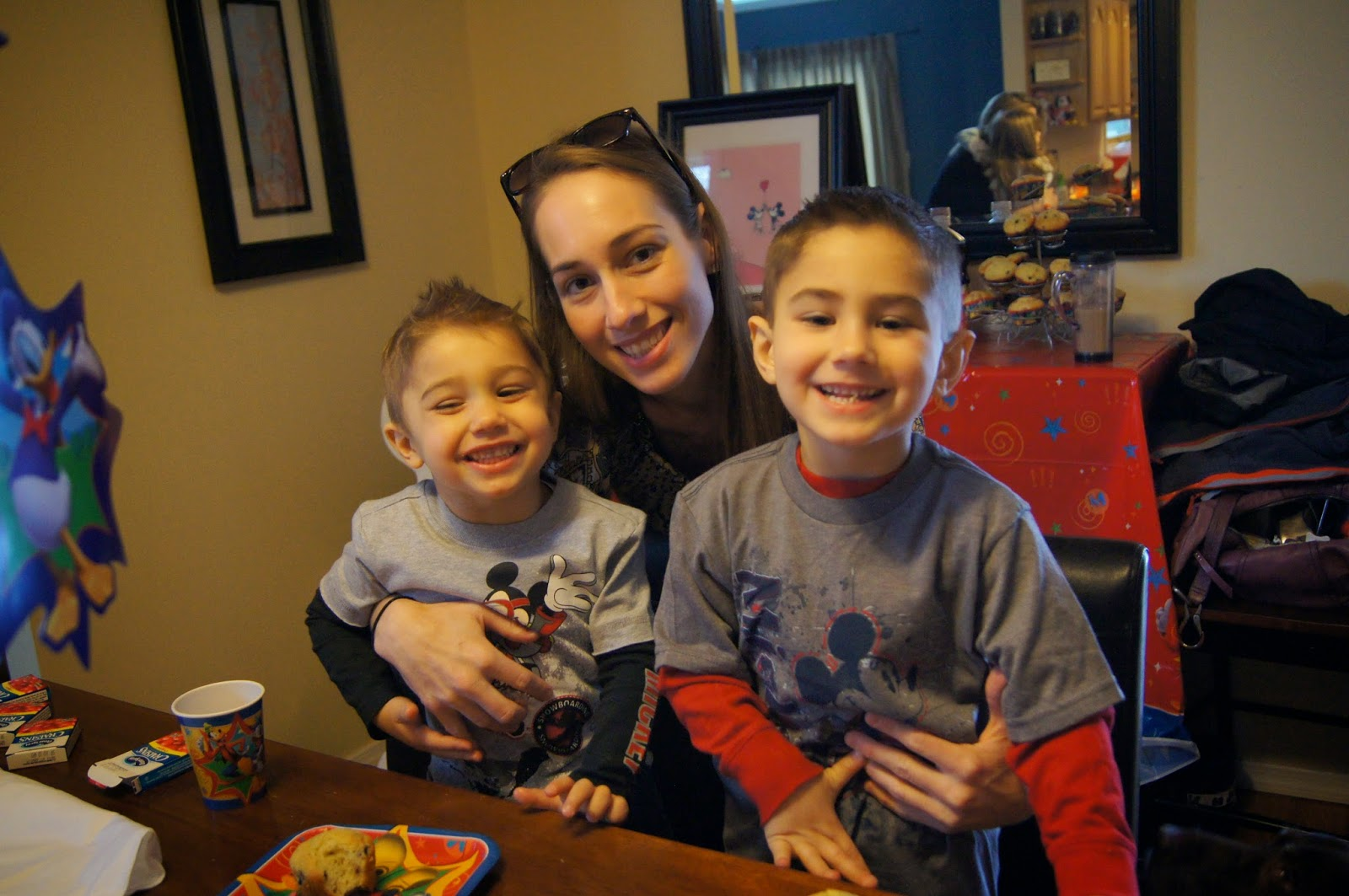 mom with two boys in mickey shirts