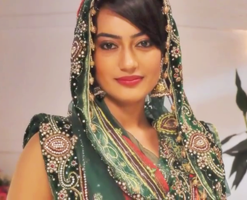 Surbhi jyoti image in green saree