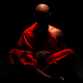 An artistic display of a Buddhist monk meditating