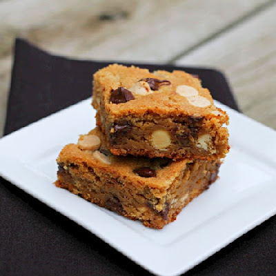 peanut butter chocolate chip blondies stacked on a white plate
