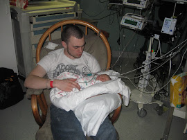 Dada getting to hold Lucas for the first time.