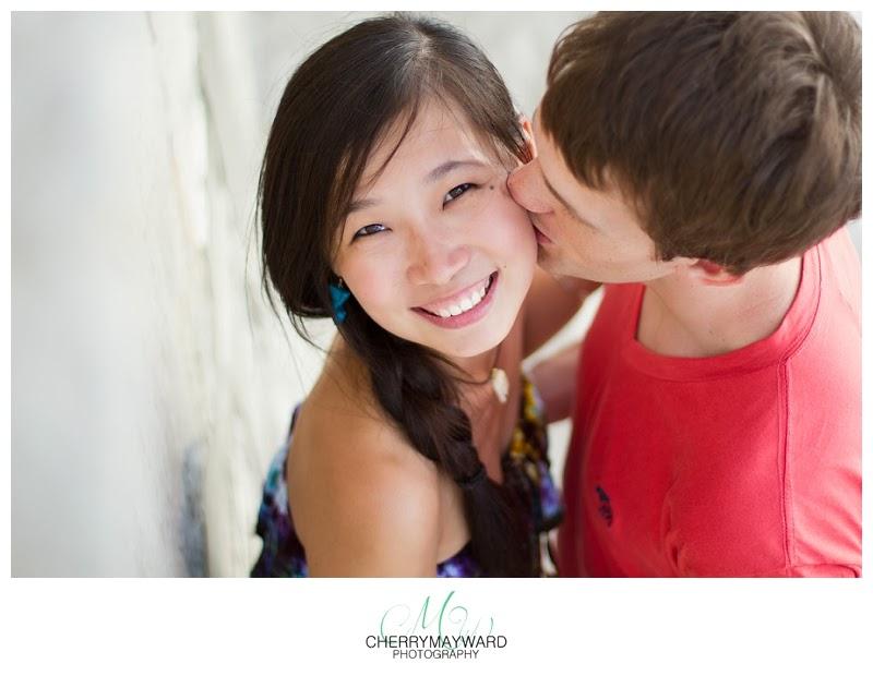 beautiful beach portrait, couple kissing, man kissing woman's cheek, wonderful photo of couple kissing, happy couple, just married, honeymoon in thailand, couple on honeymoon in thailand, couple on honeymoon on Koh Samui