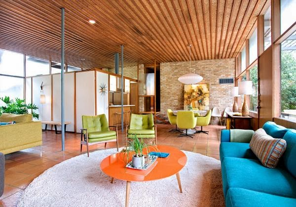 Beautiful Room With An Eclectic Style That Has The Feel Of An Outdoor.  Looks Super Stunning In Vivid Colors Brown, Blue And Orange.