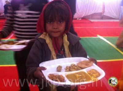 Jagadguru Shree Kripaluji Maharaj provides happy Christmas for poor Indian villagers