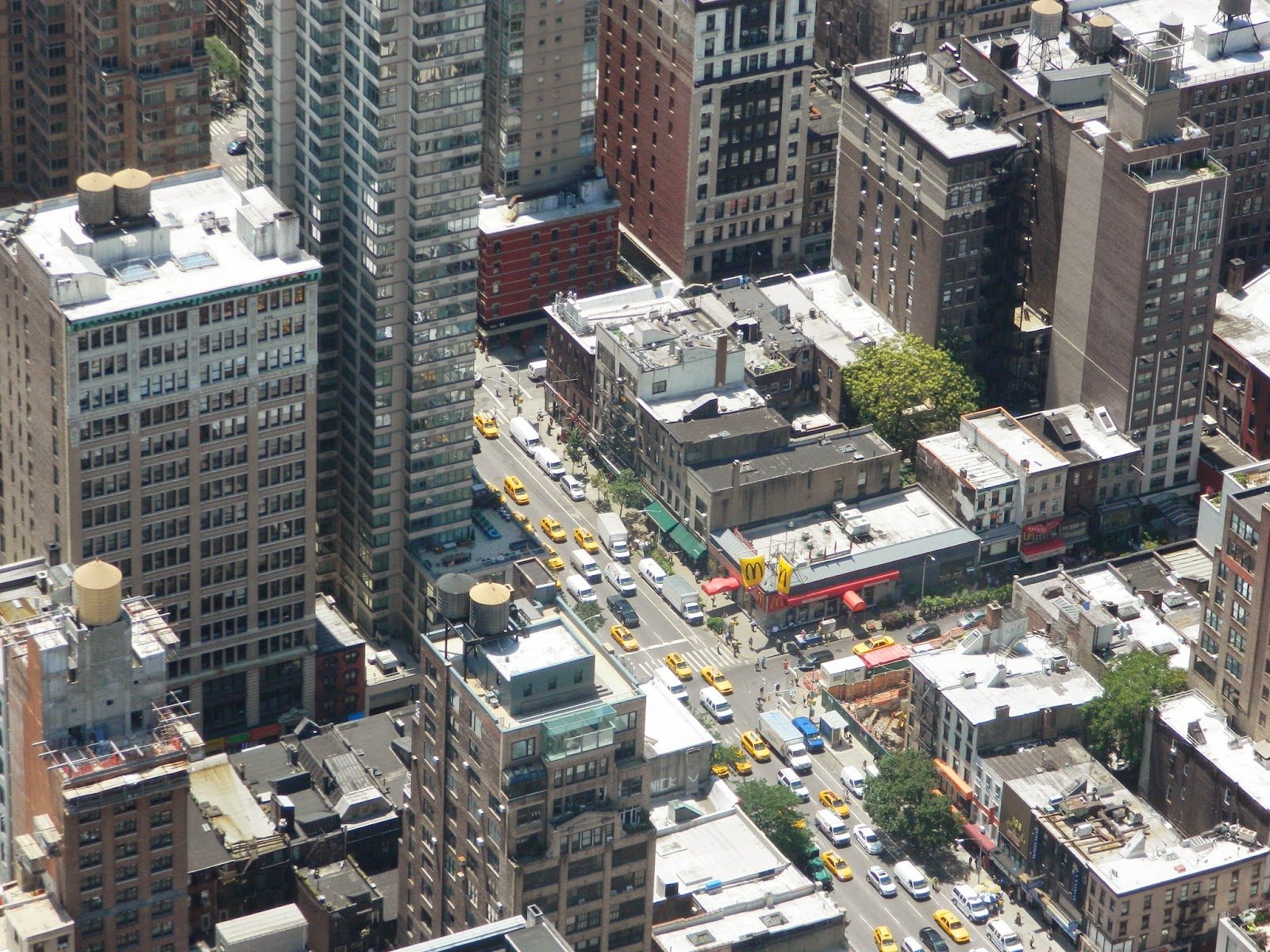 new york city empire state building streets from above yellow cabs view