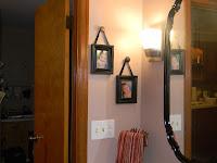 Door knobs as picture frame hangers