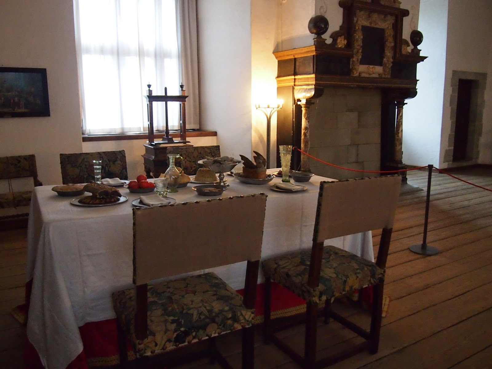 a table set with food in the helsingor castle