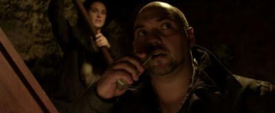 Amos (Waru) interrogates the resident spirit as Kylie (Bucknell) looks on in HOUSEBOUND