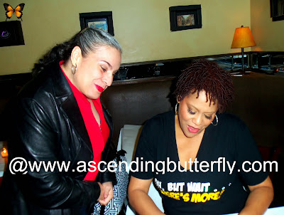 Left Mama Butterfly Right Actress Kim Coles signs autograph at Oh Wait But There's More one Woman show post show meet and greet at West Bank Cafe Laurie Beechman Theatre in New York City