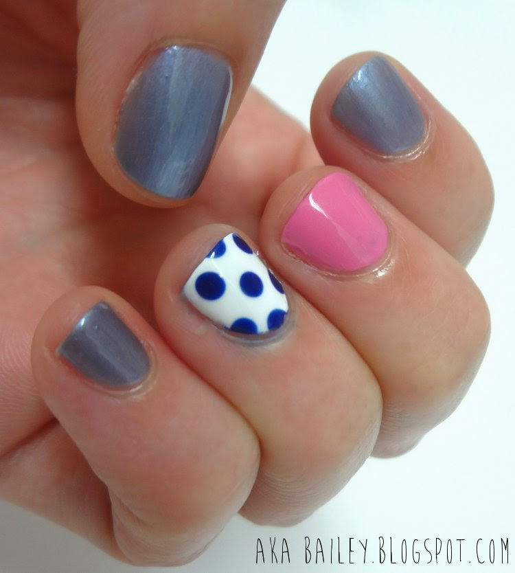 Blue nails with pink and polka dot accent nails