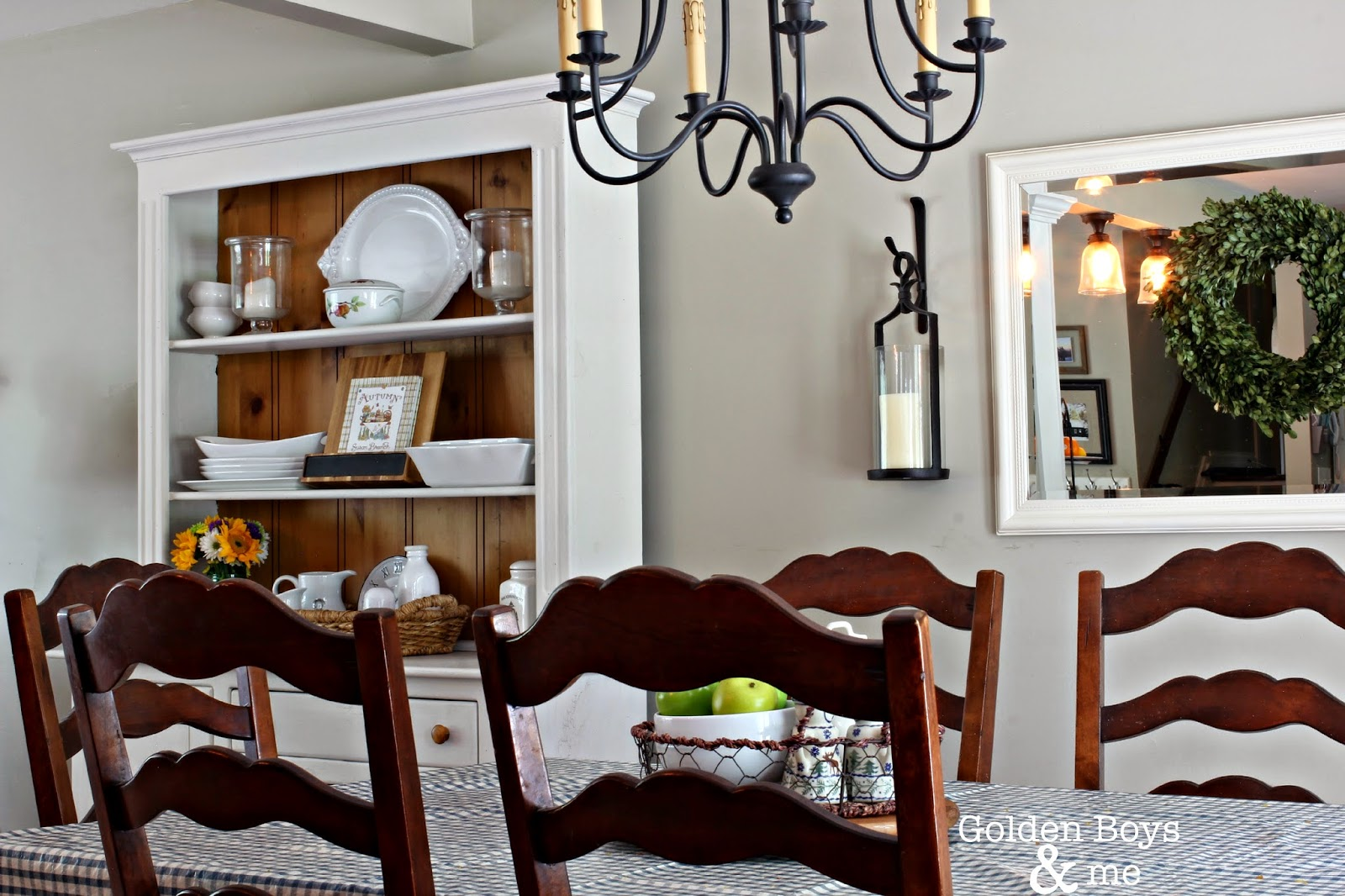 Dining room with hutch painted with chalk paint and World Imports Brondy chandelier-www.goldenboysandme.com