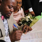 PHOTO: Is This Woman Forcing This Guy To Marry Her?