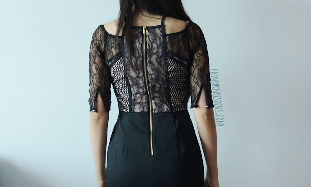 An elegant outfit featuring SheIn's dupe of the black lace Three Floor Dunn with That bodycon dress, with an asymmetrical hem and cutout design.