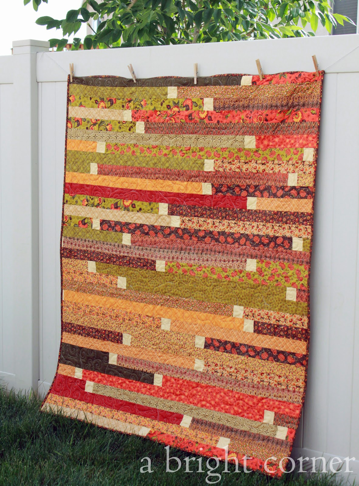 Jelly Roll Race Quilt in lovely fall colors!