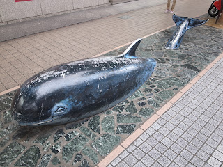 whale buried in pavement