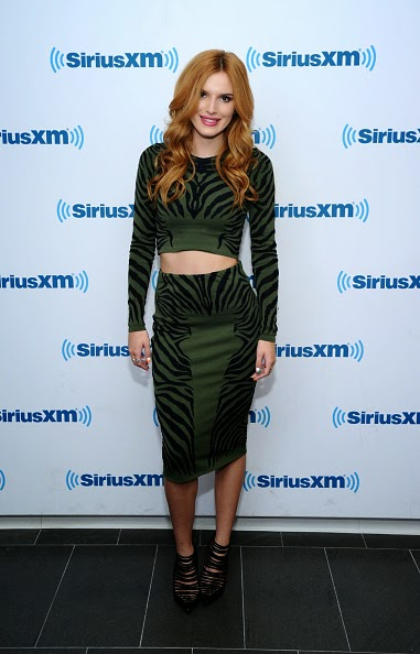 Bella Thorne flaunts a green zebra print outfit at SiriusXM Studios in NYC
