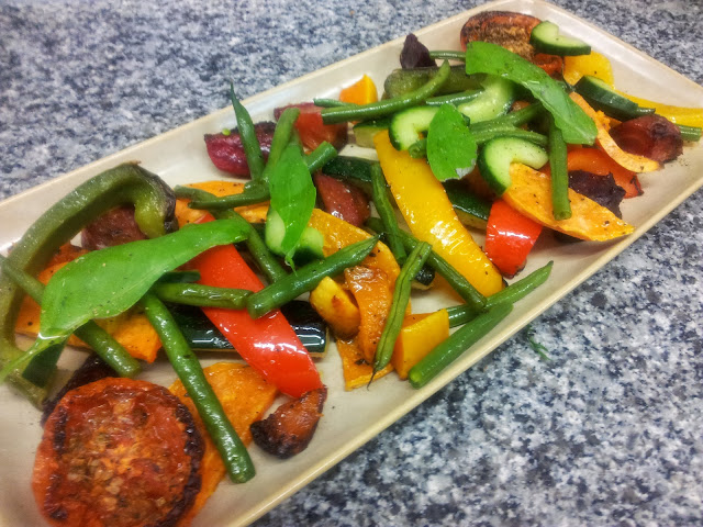 Roasted vegetable platter of tomato, sweet potato, pepper, courgette ...