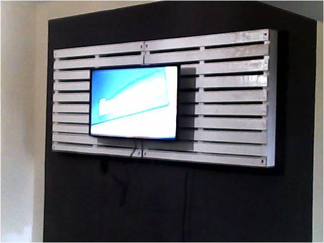 Painel de tv feito feito com pallets