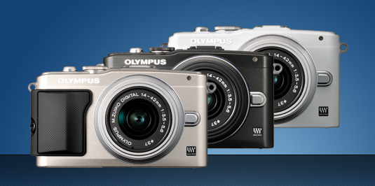 photo of the olympus pen epl5 digital cameras black, white, silver