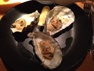 Gegratineerde oesters met sjalot en oude kaas