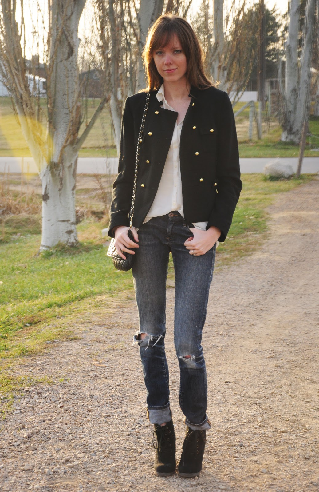 Black military jacket, ripped jeans
