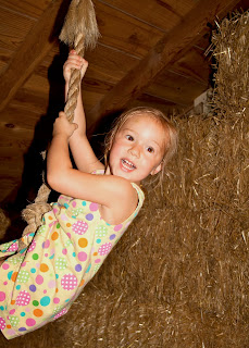 Sierra on the rope swing at Purina Farms