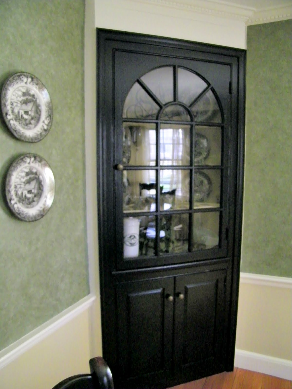 Maison decor black paint updates a traditional dining room for Black corner bathroom cabinet