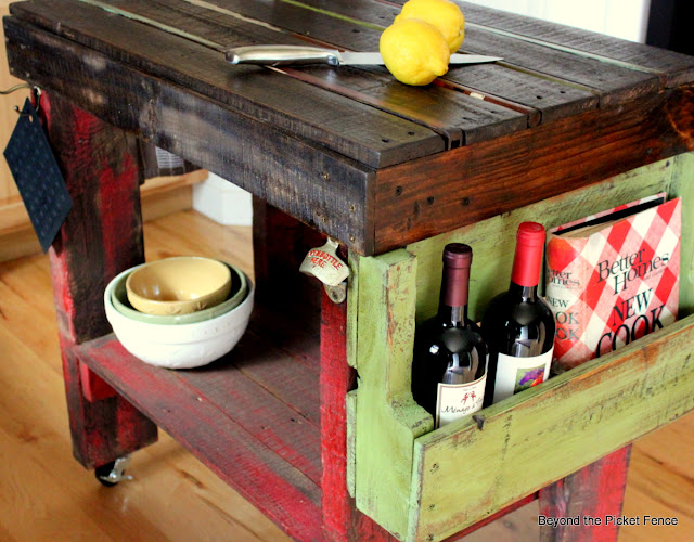 book holder, wine rack, pallet wood, DIY, reclaimed, kitchen island, shelf, http://bec4-beyondthepicketfence.blogspot.com/2012/04/pallet-island.html