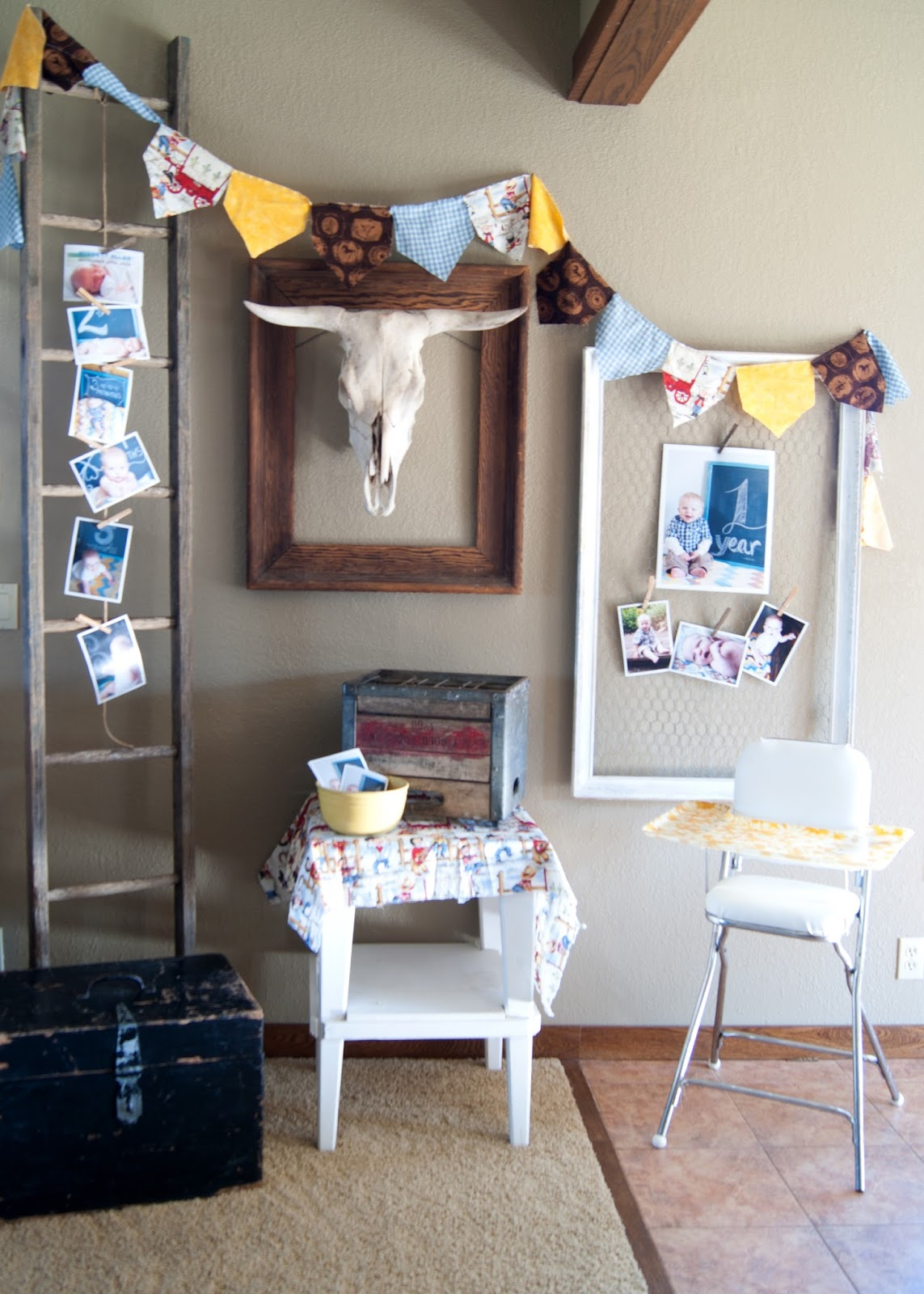 Old ladder, bull skull, bunting and photos