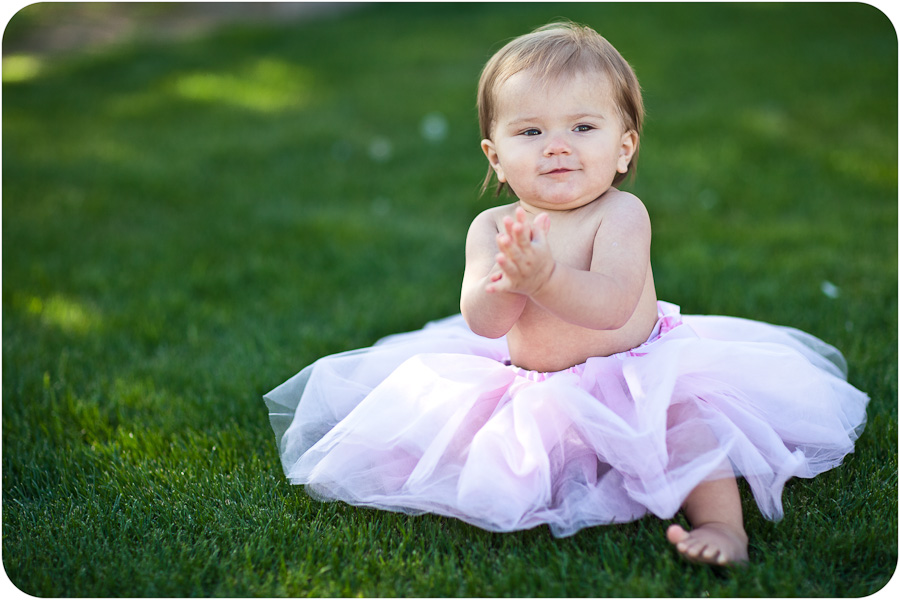 Beautiful baby wearing tutu clapping hands