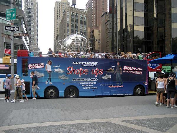 Sightseers Swing Past Earth - At Columbus Circle.