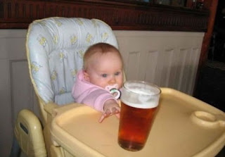 funny picture: baby takes glass of beer
