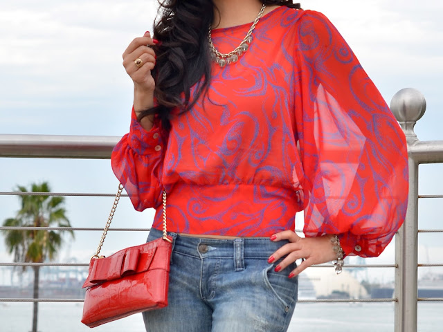 red blouse with balloon sleeves kate spade red bow patent leather purse banana republic gold and crystal bead jewelry Frankie B. low rise flare jeans