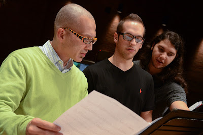 UConn Jazz Studies director, Earl MacDonald ironing out some musical details with his students.