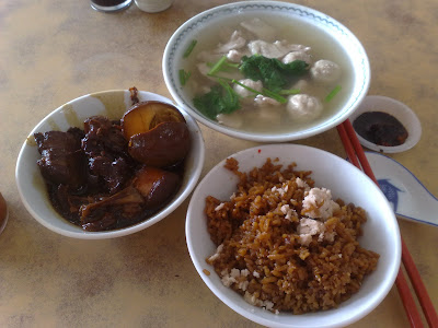Yam Rice with a bowl or pork stew with meat balls and a bowl of ...