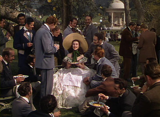 Vivien Leigh as Scarlet O'Hara entertaining suitors in Gone with the Wind movieloversreviews.blogspot.com