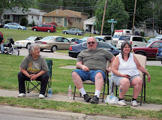 unhappy family, smokes, sits, parade watching