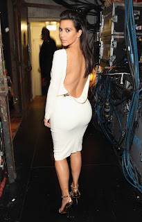 Kim Kardashian spins for cameras and shows off her great ass in a tight white dress
