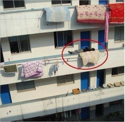 Guy Sleeping on a Building Balcony on Second Floor, It Happens only in India